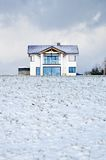 House in a winter meadow Stock Image