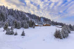House in winter mountains. With smoke Stock Images