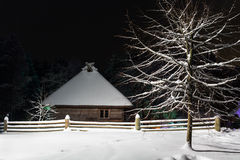 House in the winter night Stock Photo