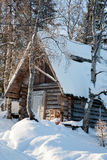 House in winter wood. Old wooden small house in winter wood stock photos