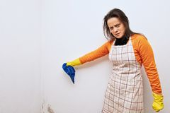 House woman finds mold in the corner of the house.  royalty free stock photo