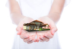 House on woman hands over body  Royalty Free Stock Photography