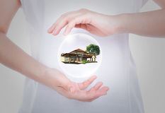 House on woman hands over body isolated Royalty Free Stock Photo