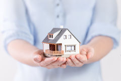 House in woman's hands Royalty Free Stock Photo