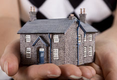 House in womans hand Stock Images
