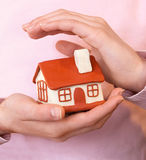 House in the women's  hands Stock Images