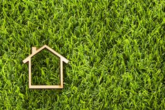 House in wood on green grass - Ecological concept. Top view stock images