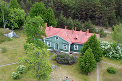 House in the wood. Green house with red roof in the wood stock photography