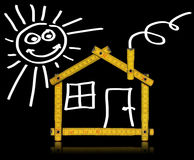 House Wood Meter Tool on Black Background. Yellow meter tool forming a house with sun, door and window on black background vector illustration