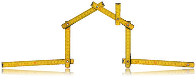 House - Wood Meter Tool. Wooden yellow meter tool forming a house with reflection on white background royalty free illustration