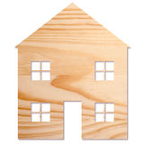House in wood. House shape cut out of wood, on white background royalty free stock photo