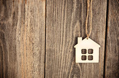 House on wooden background Royalty Free Stock Photos