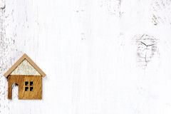 House on wooden background - property real estate concept Royalty Free Stock Image