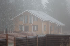 House of wooden beam in mist Stock Images