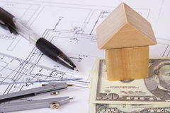 House of wooden blocks, currencies dollar and accessories for drawing, building house concept Royalty Free Stock Photo