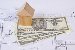 House of wooden blocks and currencies dollar on construction drawing, building house concept Royalty Free Stock Image