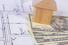 House of wooden blocks and currencies dollar on construction drawing, building house concept Royalty Free Stock Images