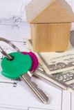 House of wooden blocks, keys and currencies dollar on construction drawing, building house concept Stock Photography