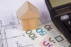 House of wooden blocks and polish money with calculator on construction drawing, building house concept Stock Photos