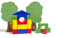 House of wooden blocks, wooden figures of trees, euro money, mod Royalty Free Stock Photo