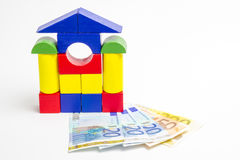 House of wooden blocks, wooden figures of trees, euro money, mod Royalty Free Stock Image