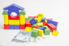 House of wooden blocks, wooden figures of trees, euro money, mod Royalty Free Stock Images
