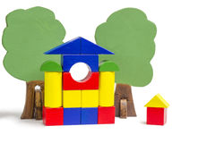 House of wooden blocks, wooden figures of trees, euro money, mod Royalty Free Stock Photography
