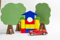 House of wooden blocks, wooden figures of trees, euro money, mod Stock Photography