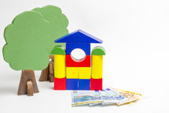 House of wooden blocks, wooden figures of trees, euro money, mod Stock Photo