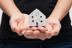 House Wooden in both hands. A wooden house in both hands royalty free stock photos