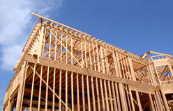 House Wooden Frame. House being built in wooden frame against a blue sky Royalty Free Stock Photos