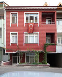 House Wooden Ottoman Style. Red house wooden Ottoman style with turkish flag Royalty Free Stock Photography