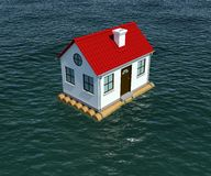 House on wooden raft floats on water Royalty Free Stock Image