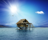 House on wooden stilts in the middle of the ocean Royalty Free Stock Photo