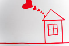 House on wooden white background with red hearts. The concept of. Valentine`s Day Stock Photo