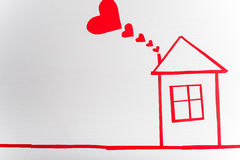 House on wooden white background with red hearts. The concept of. Valentine`s Day Royalty Free Stock Photography