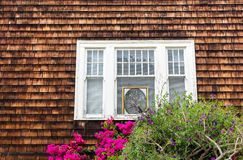 House with wooden window and flowers Stock Images
