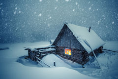 House. Wooden house in winter forest Stock Photography