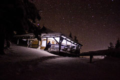 House in the woods. At night under the stars Stock Photo