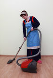 House work. Housewife using a vacuum cleaner to clean the floor Stock Image