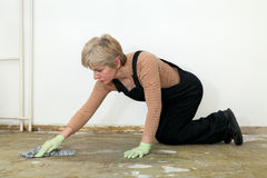House work, woman cleaning floor Royalty Free Stock Photos