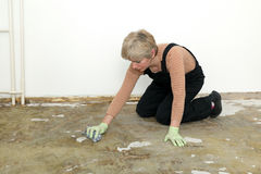 House work, woman cleaning floor Stock Images