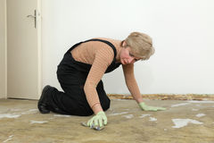 House work, woman cleaning floor Stock Image