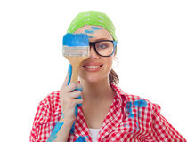 House worker woman. Playful woman holding paint brush over her eye, girl ready for painting, isolated on white Stock Photography