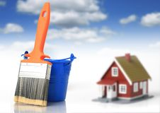 House works. Brush and bucket. House on the background Stock Photography