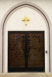 House of Worship Door With Security Pad. An ornate door church door in arched recess with security pad Stock Photos