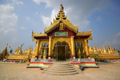 House of Worship from the main entrance with colourful base platform in Shwemawdaw Pagoda at Bago, Myanmar Stock Images