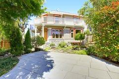 House with wrap-around walkout deck. Backyard view Stock Photo