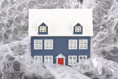 House wrapped in bubble wrap Stock Images