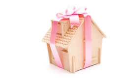 House wrapped with ribbon Stock Image